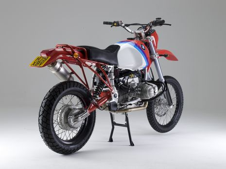 Rear image of the highly modified 1989 BMW R100GS with ground-up restoration by Richard Moore using unique Moorespeed components and replica Paris-Dakar paint scheme.